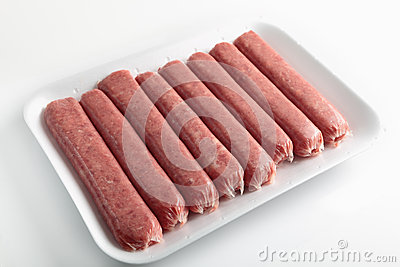 Beef sausages on a tray