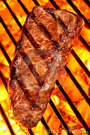 Beef steak on a fire hot barbecue grill