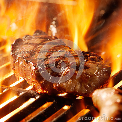 Free Beef Steak On The Grill With Flames. Stock Photography - 26454122