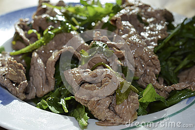 Beef strips with rocket