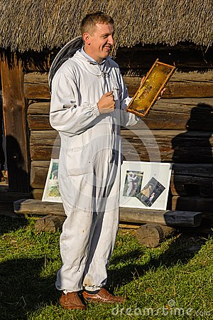 Beekeeper showing honeycomb frame Editorial Photo