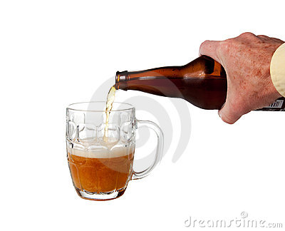 Beer being poured from bottle