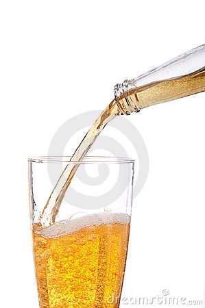 Beer being poured into a pilsner glass