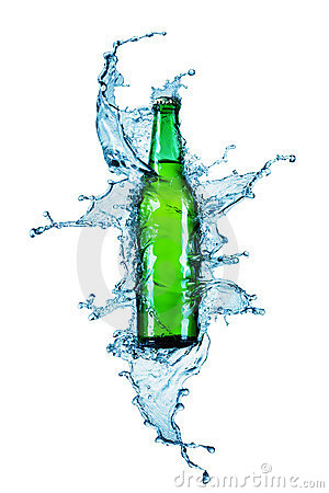 Beer bottle being poured in a water