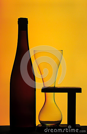 Beer bottle and glass on wooden stand