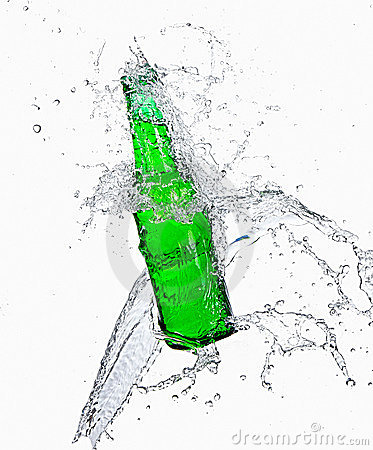 Beer bottle with water splashing out of bottle