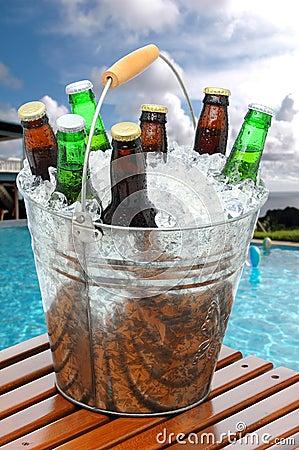 Free Beer Bucket On Poolside Teak Table Stock Photos - 18007603