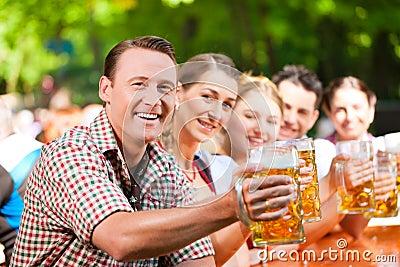 In Beer garden - friends drinking beer