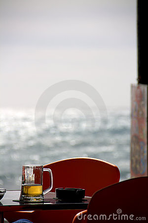 Beer glass in ocean window