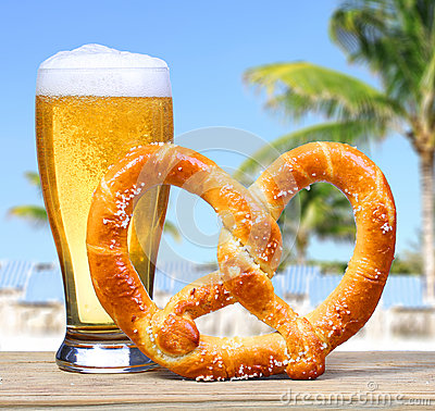 Free Beer Glass With German Pretzel Over Beach View With Palms. Royalty Free Stock Photo - 36678225