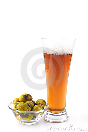 Free Beer Glass With Gold Olives Stock Images - 9545364