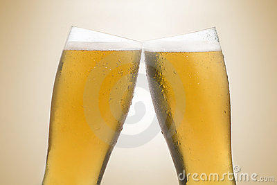 beer glasses making a toast