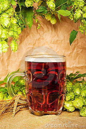 Beer mug with hop and wheat