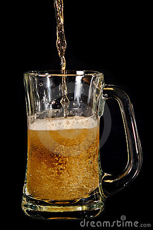 Beer poured into glass mug