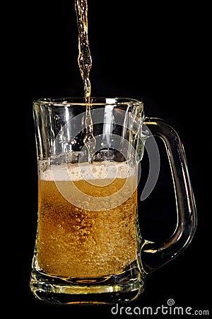Beer poured into glass mug