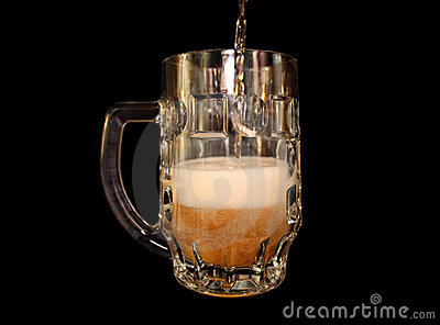 Beer is poured into a mug