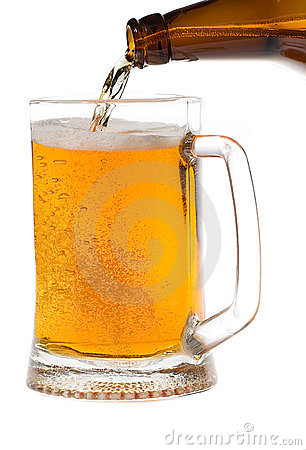 Beer is poured in a mug