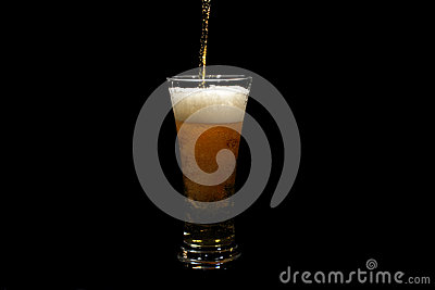 Beer pouring into a glass