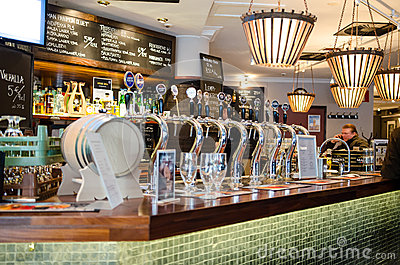 Beer taps in a finnish bar Editorial Photography