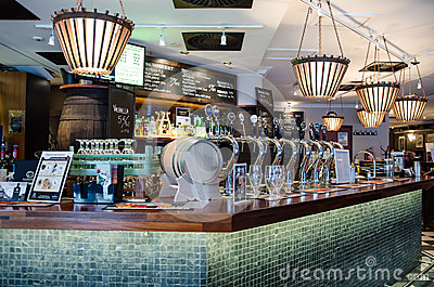 Beer taps in a finnish bar Editorial Stock Photo
