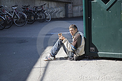 Begging for money Editorial Stock Photo