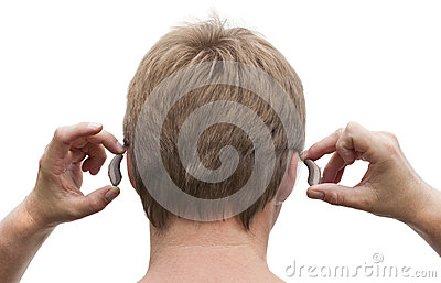 Behind-the-ear hearing aid putting on