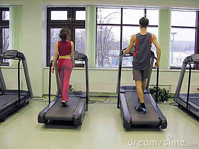 Behind girl and boy in health club