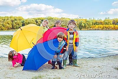 Behind umbrellas