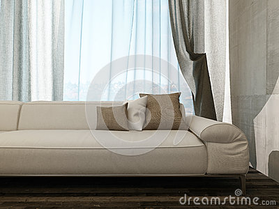 Beige couch against curtains