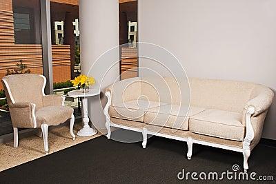 Beige furniture in large room