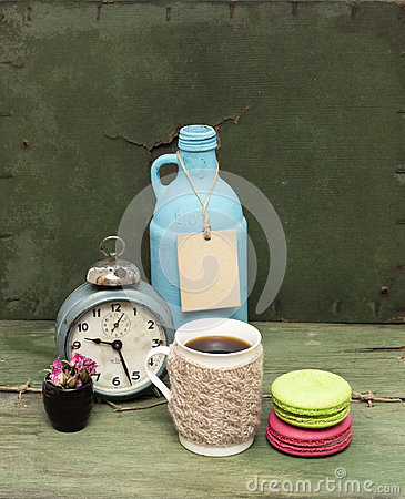 Free Beige Knitted Mug, Macaroons, Blue Bottle And Rough Paper Bag Background On Green Grunge Background. Nude Still Life. Stock Photography - 99284832