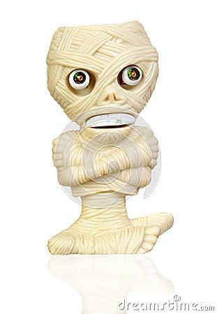 Beige plastic toy as a mummy