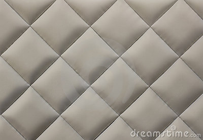 Beige quilted fabric background