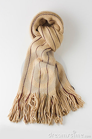 Beige winter wool scarf on white.