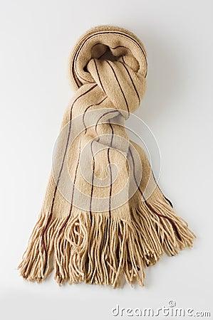 Beige winter wool scarf on white.