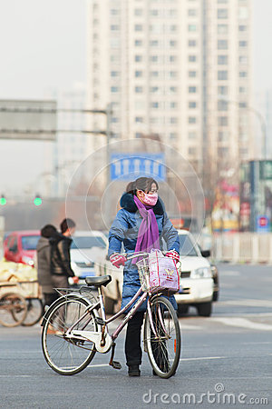 Beijing Resident with smog protection Editorial Stock Photo