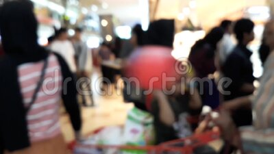 Unrecognied People / Pedestrian Walk / Busy Road in a mall with blurred/defocused. Crowd on a busy road. People are busy. BEKASI, INDONESIA, APRIL 17, 2020 stock video footage