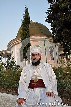 Bektashi dervish sitting on a wall of tekke Editorial Photography