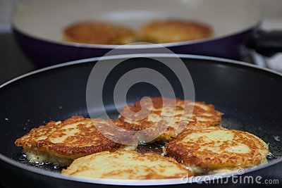 Belarusian potato pancakes fried in a pan