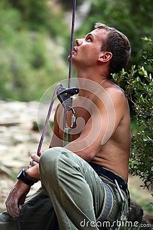 Belayer watching lead climber