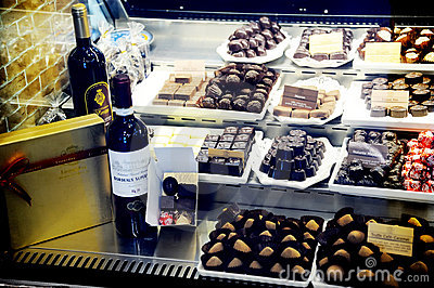 Belgian leonidas  chocolates and wine Editorial Stock Image