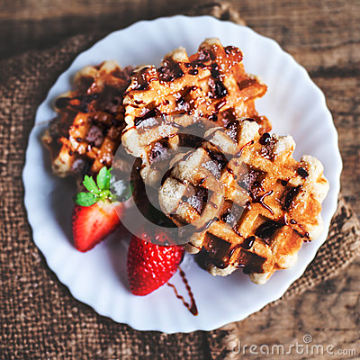 Free Belgian Waffles Topped With Strawberries, Syrup And Icing. Homem Stock Image - 82530741