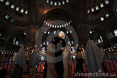 Believer in Blue Mosque Wide Angle