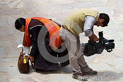 Believer and operator at mak dance festival in Hemis monastery Editorial Image