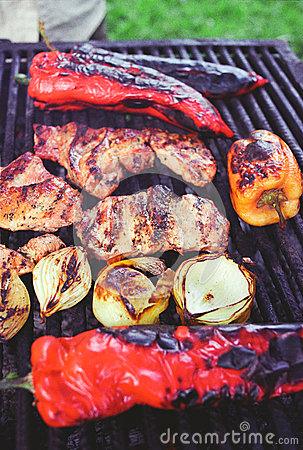 Bell pepper, onion and meat on grill