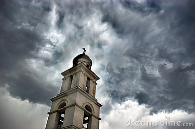 Bell tower under dramatic sky