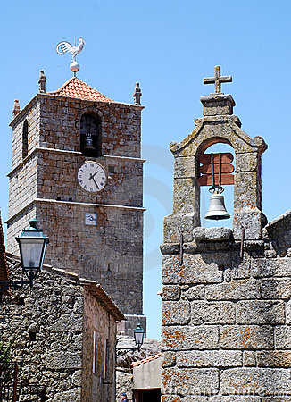 Bell towers  with clock, cross and weathercock