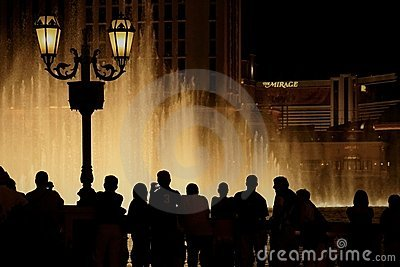 Bellagio dancing fountains people silhouettes Editorial Stock Image