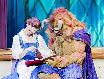 Belle and Beast Read a Book Editorial Stock Photo