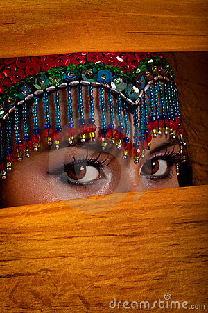 Free Belly Dancer Peeking From Behind Veil Stock Images - 9850404